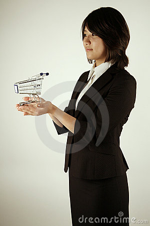 Asian businesswoman with small trolley