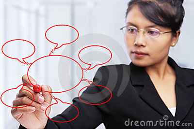 Asian businesswoman writing on glass board.