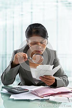 Asian bussinesswoman checking bills