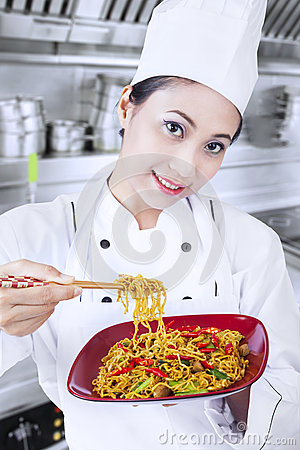 Free Asian Chef And Fried Noodle In Kitchen Stock Photography - 30025372