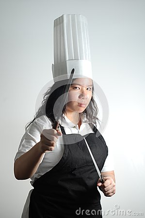 Asian Chef preparing to fight with knifes