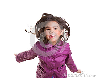 Asian child girl jumping happy with winter purple coat