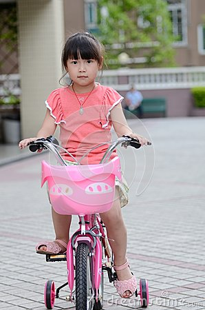 Asian child Riding a bicycle
