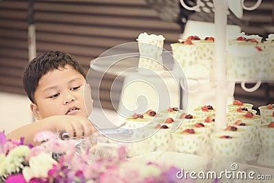 Asian children were picked cake