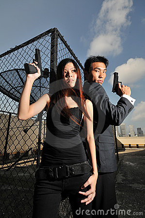 Asian chinese couple carrying guns on rooftop 2