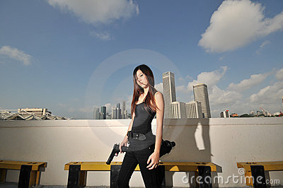 Asian Chinese Girl carrying a Pistol 2
