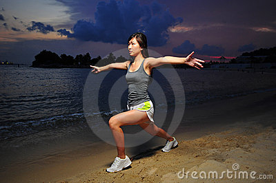 Asian Chinese Girl doing stretching on the beach