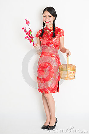 Free Asian Chinese Girl Holding Gift Basket And Plum Blossom Stock Photos - 47979283