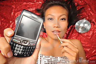 Asian Chinese Girl putting lipstick and holding hp