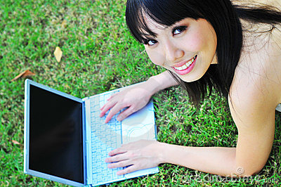 Asian Chinese Girl using laptop and smiling sweet