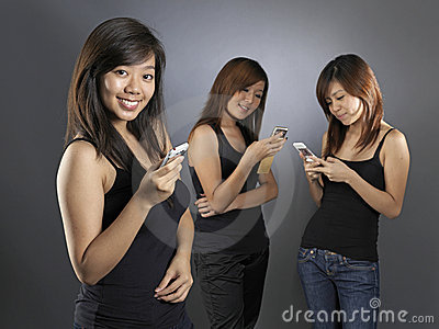 Asian chinese girls using their mobile phones