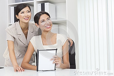 Asian Chinese & Hispanic Businesswomen Using Tablet Computer