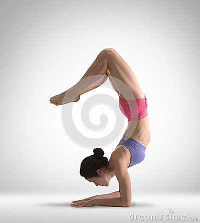 Asian Chinese Lady doing Yoga in colored clothing