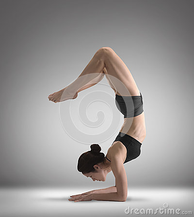 Asian Chinese Lady doing Yoga in dark clothing