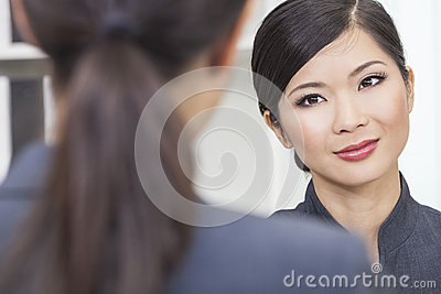 Asian Chinese Woman or Businesswoman in Meeting