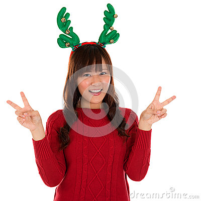 Free Asian Christmas Girl Showing Victory Sign. Royalty Free Stock Images - 31400239