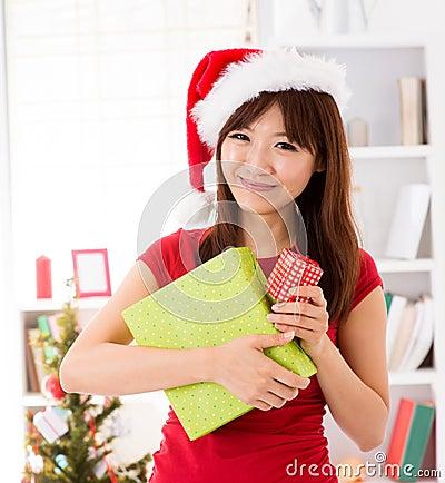 Asian Christmas woman with gift