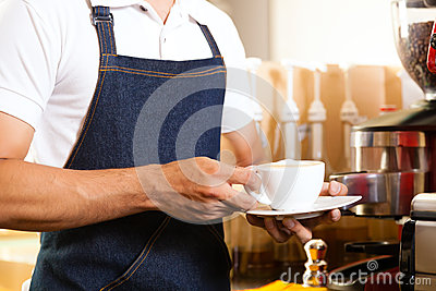 Asian Coffeeshop - barista presents coffee