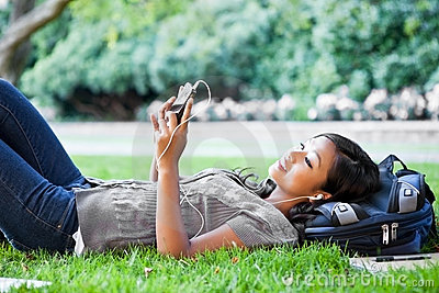 Asian college student listening to music