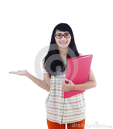 Asian college student showing something on copyspace