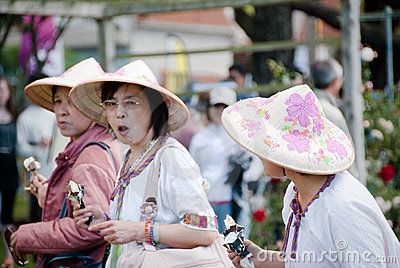 Asian colorful Hats.Festival of Roses.Auckland.NZ Editorial Photo