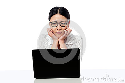Asian corporate woman thinking something