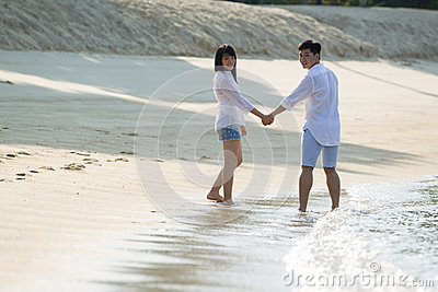 Asian couple on the beach.