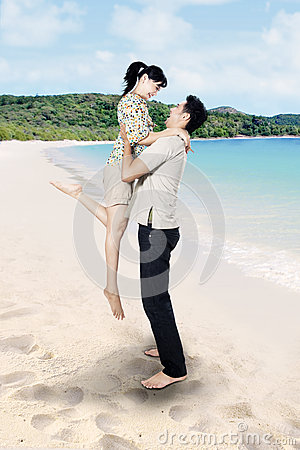 Asian couple enjoy time at beach