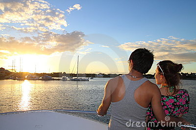 An asian couple enjoying sunset