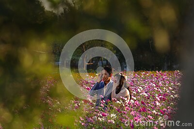 Asian Couple On Flowering Field Free Public Domain Cc0 Image