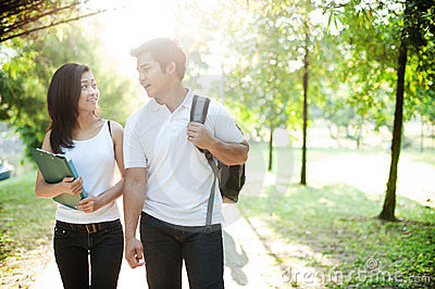 Asian couple going to school