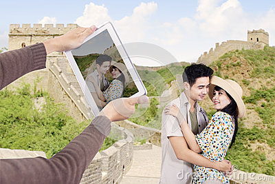 Asian couple at great wall of China