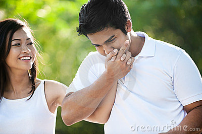 Asian Couple Hand Kissing