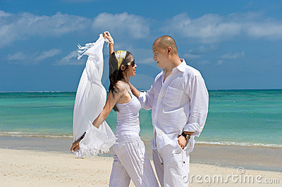 Asian couple honeymoon at the beach