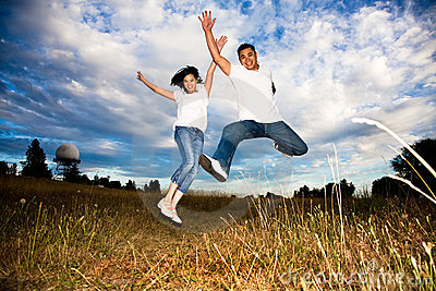 Asian couple jumping for joy