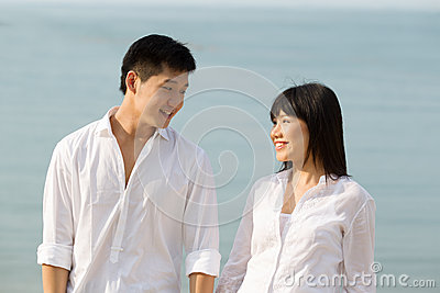 Asian couple looking at each other