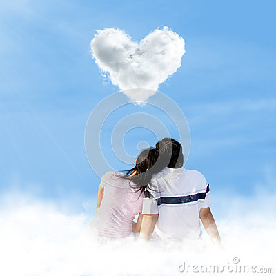 Asian couple looking at love clouds