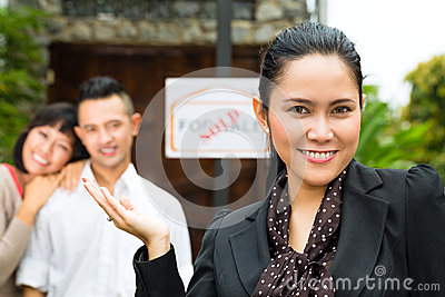Asian couple looking for real estate