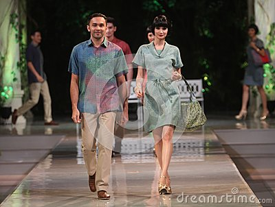 Asian couple model wearing batik at fashion show runway Editorial Stock Image