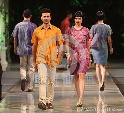 Asian couple model wearing batik at fashion show runway Editorial Photo