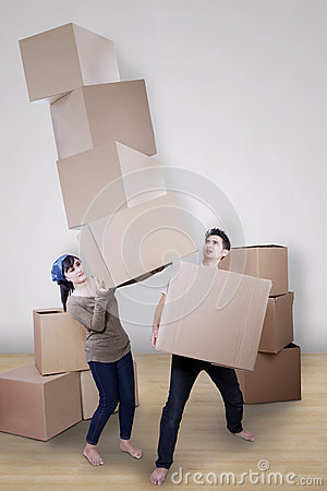 Asian couple moving boxes