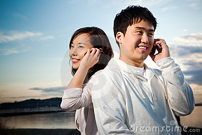 Asian couple on the phone