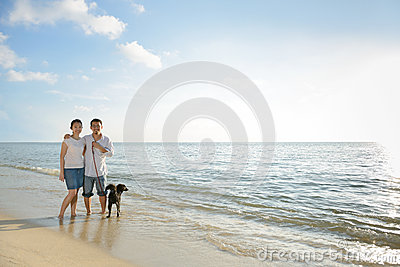 Couples with dog at beach