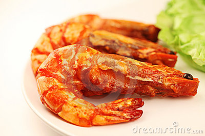 Asian cuisine. Fried prawns on tomato sauce
