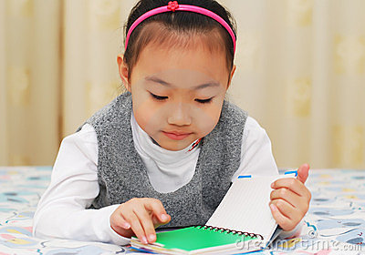 Asian cute girl reading book