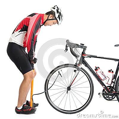 Free Asian Cyclist Using Air-pump Royalty Free Stock Image - 43992386