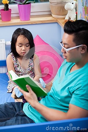 Asian Dad Reading A Fairytale Stock Photo - Image: 44620052