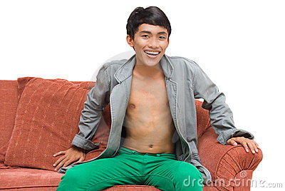 Asian dandy at leisure on couch