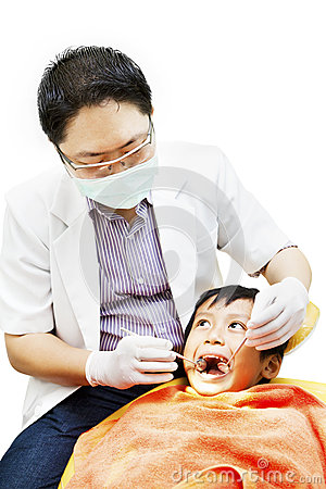 Asian dentist and his little patient
