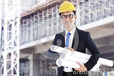 Asian developer with blueprints